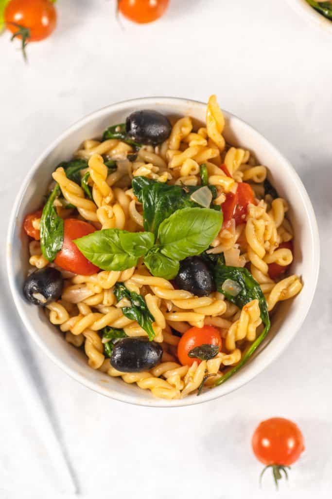 One pot pasta dish finish in a white bowl top view