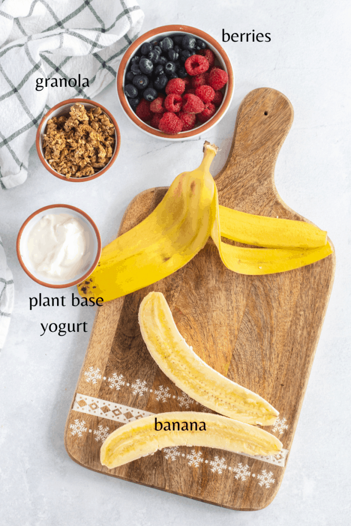 All the ingredients you need to make this recipe, banana, yogurt, granola and berries