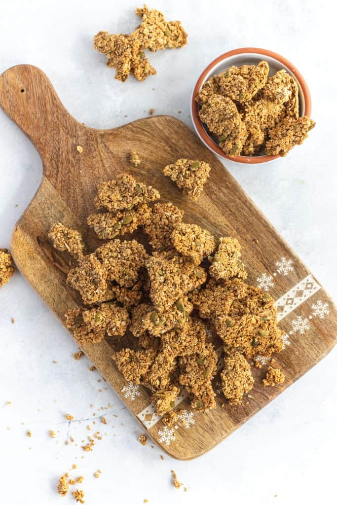Pieces of granola Cluster on a wooden board