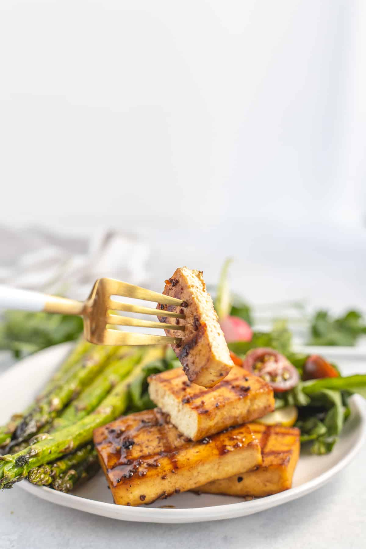 Fork with a bite of grilled tofu