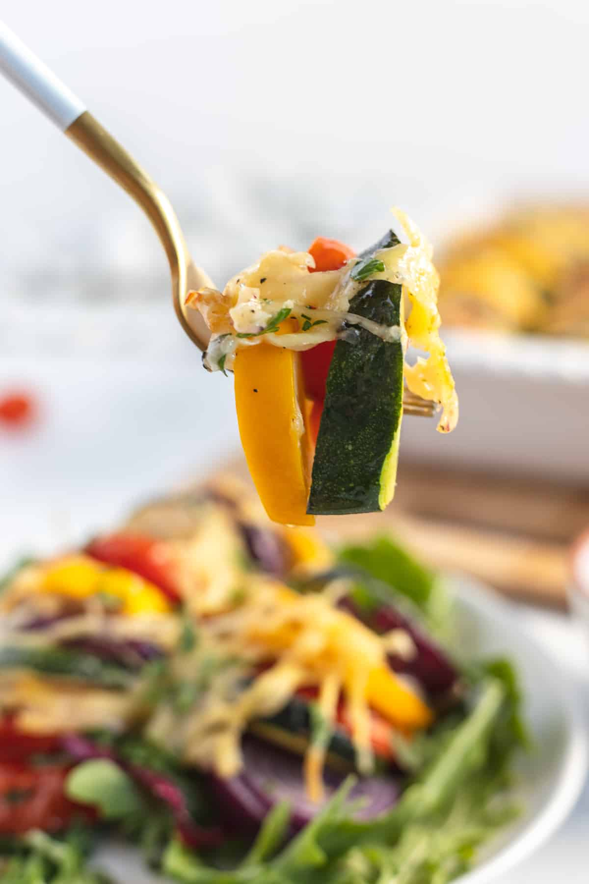 fork with cooked vegetables