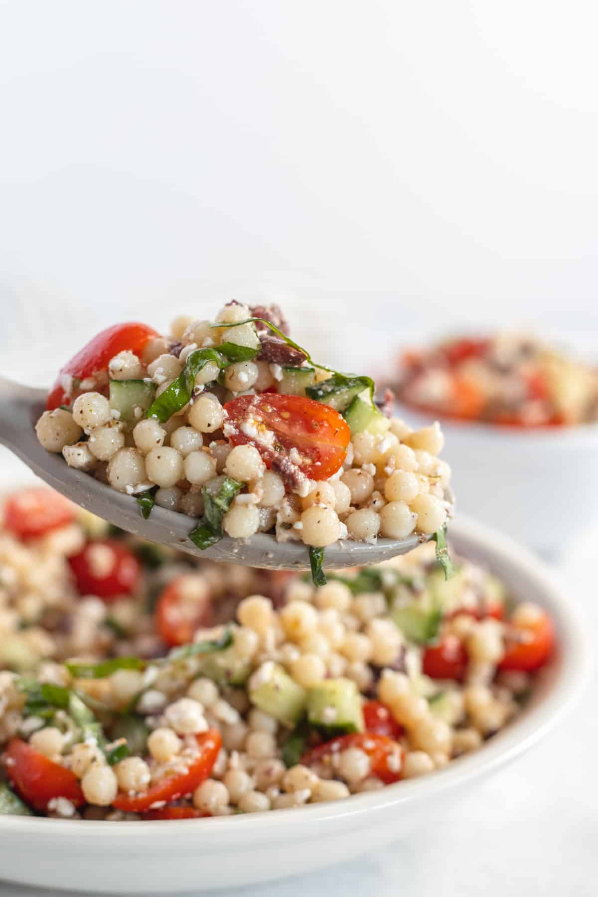 Serving spoon of the Pearl Couscous Salad