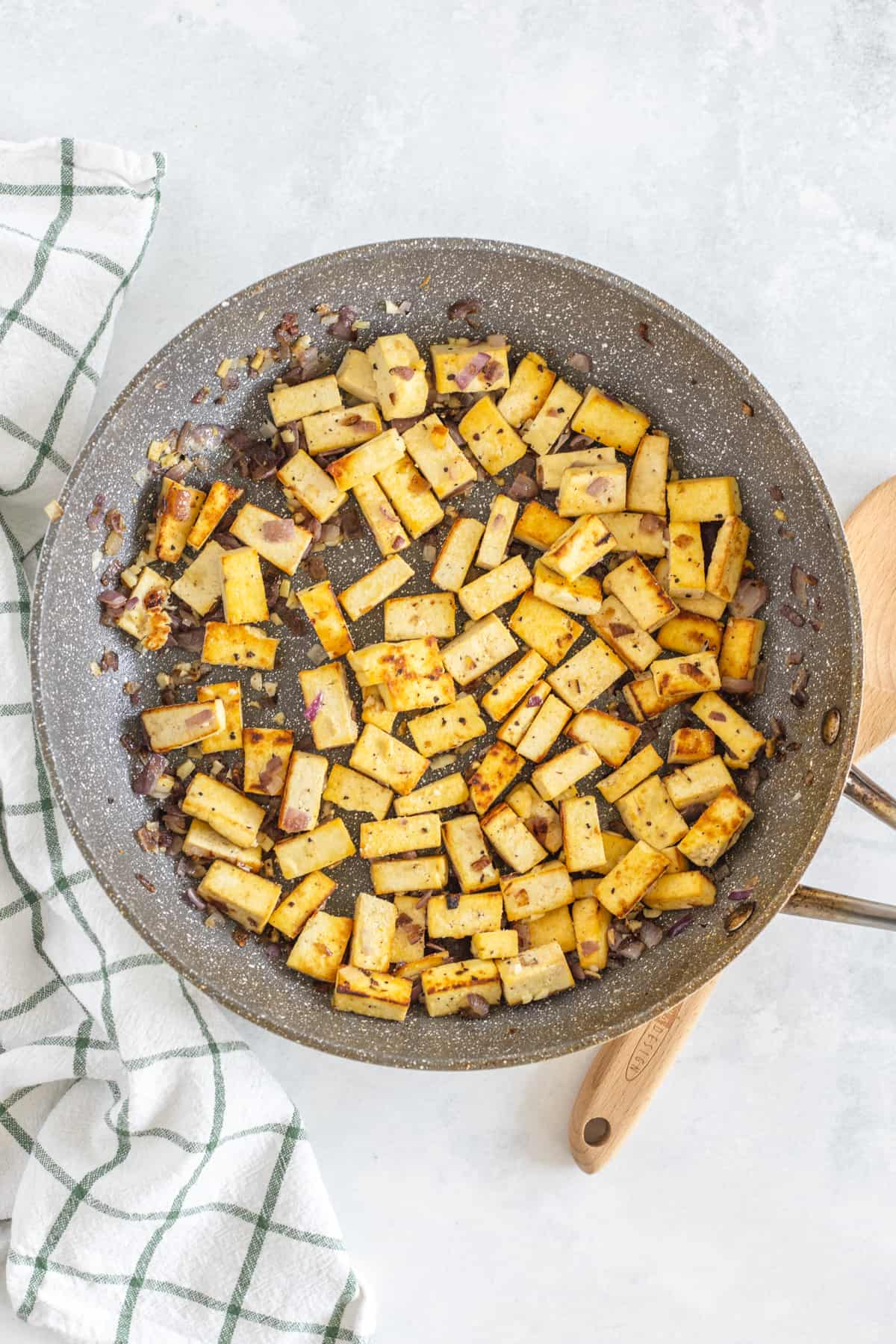 Cooked tofu in a skillet